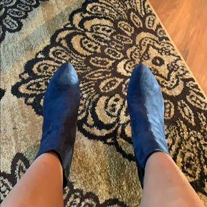 Navy blue suede and black stretch material boots